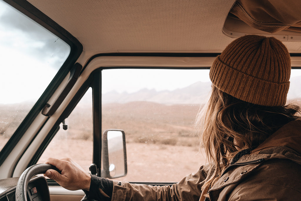 Driver Alexander Knorr takes in the view whilst driving vintage van through South Australian Desert