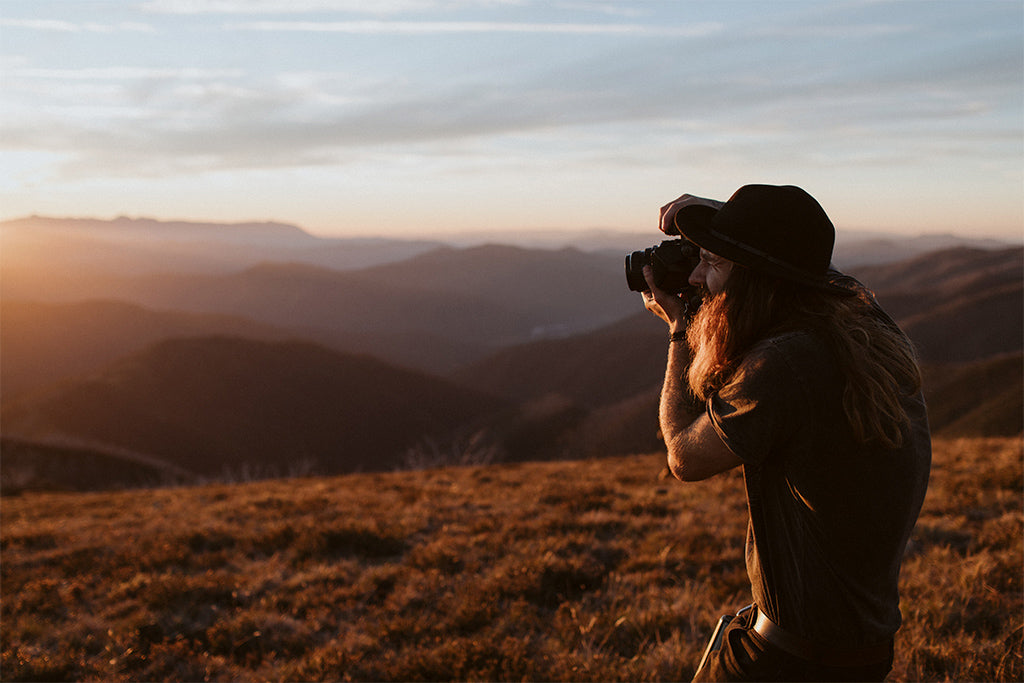 Joel Aston of EXSPD photography workshops wears Will & Bear wide brim hat whilst capturing the sunset