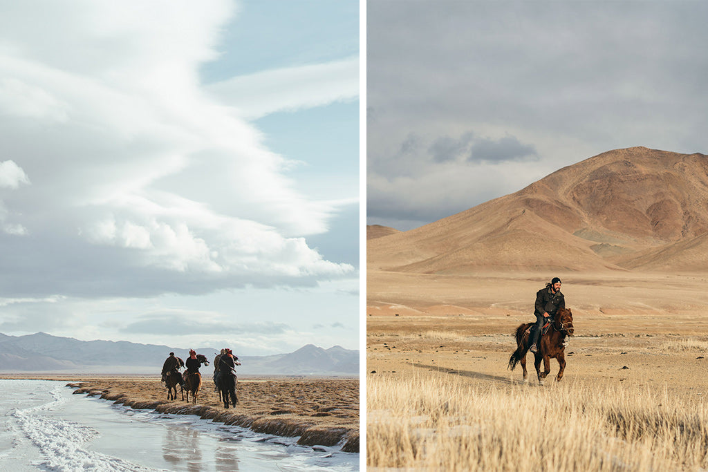 Mongolian tribe ride horses through open plains of frozen land