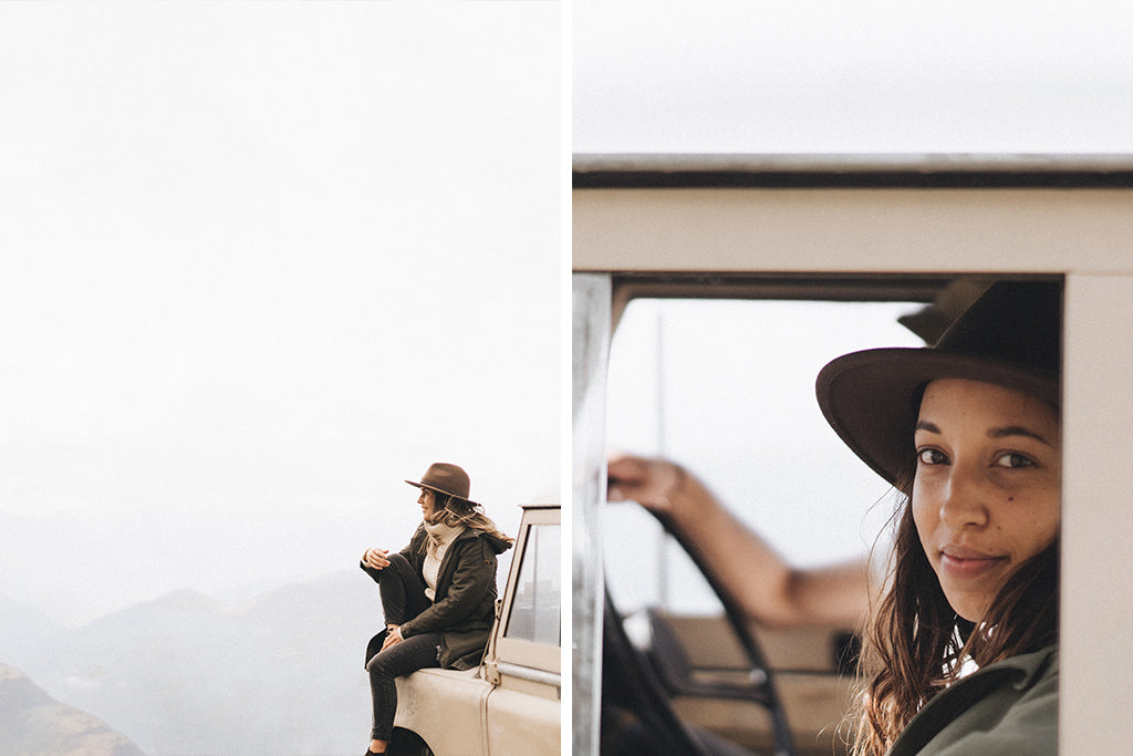 "alt=""female driver in a Will & Bear William Brown hat sitting on the bonnet of a vintage land cruiser in New Zealand"""
