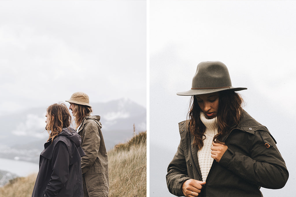 "alt=""man in Fischer Sand Bucket Hat with friend looking at view from top of the hill in New Zealand"""