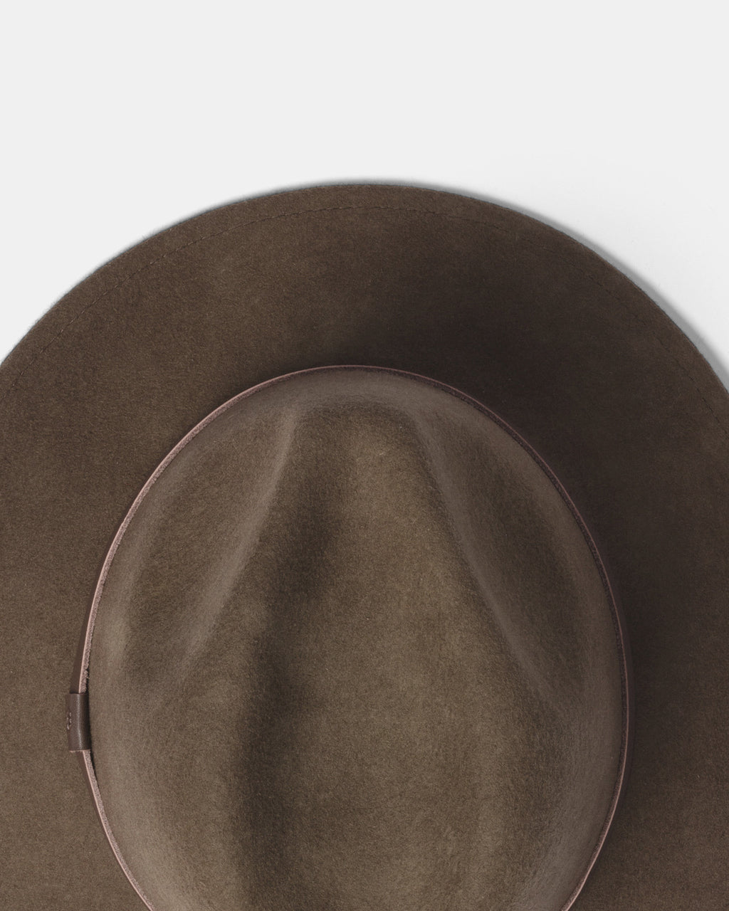 ... moulding to your head for the perfect fit – William will grow with you.  The brim can be shaped to sit up or down. Also available in Black. 0e0542a873f