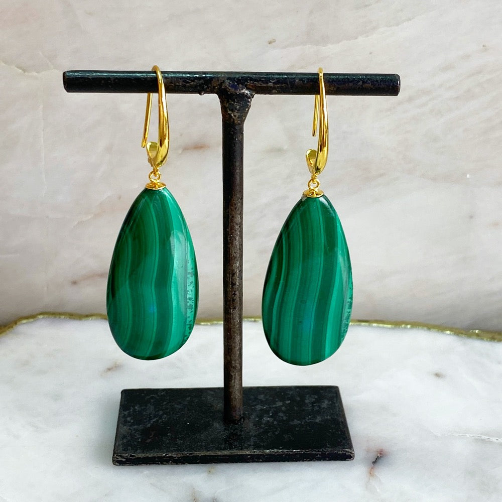 XL Malachite Earrings hanging from a earring post