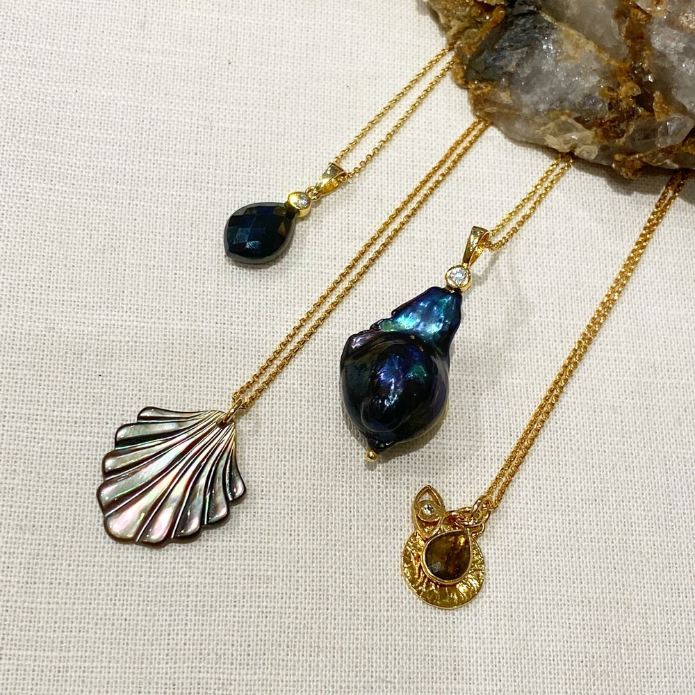 Black Fan Seashell Pendant with other pendants