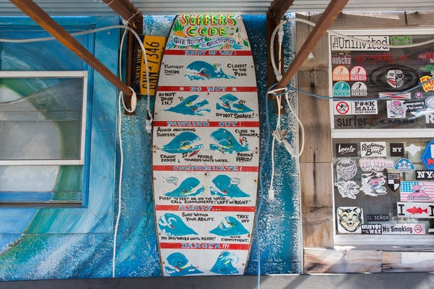 "The ""Surfer's Code"" is displayed at the Rockaway Beach Surf Club. Ryan Struck for Rolling Stone"