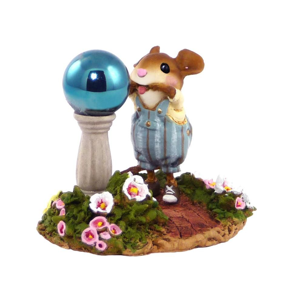 A Mouse Making a Funny Face in a Garden Ball