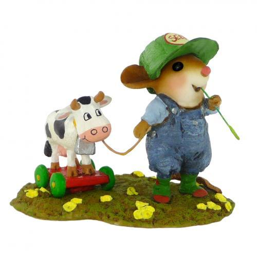 Mouse Playing with Toy Cow