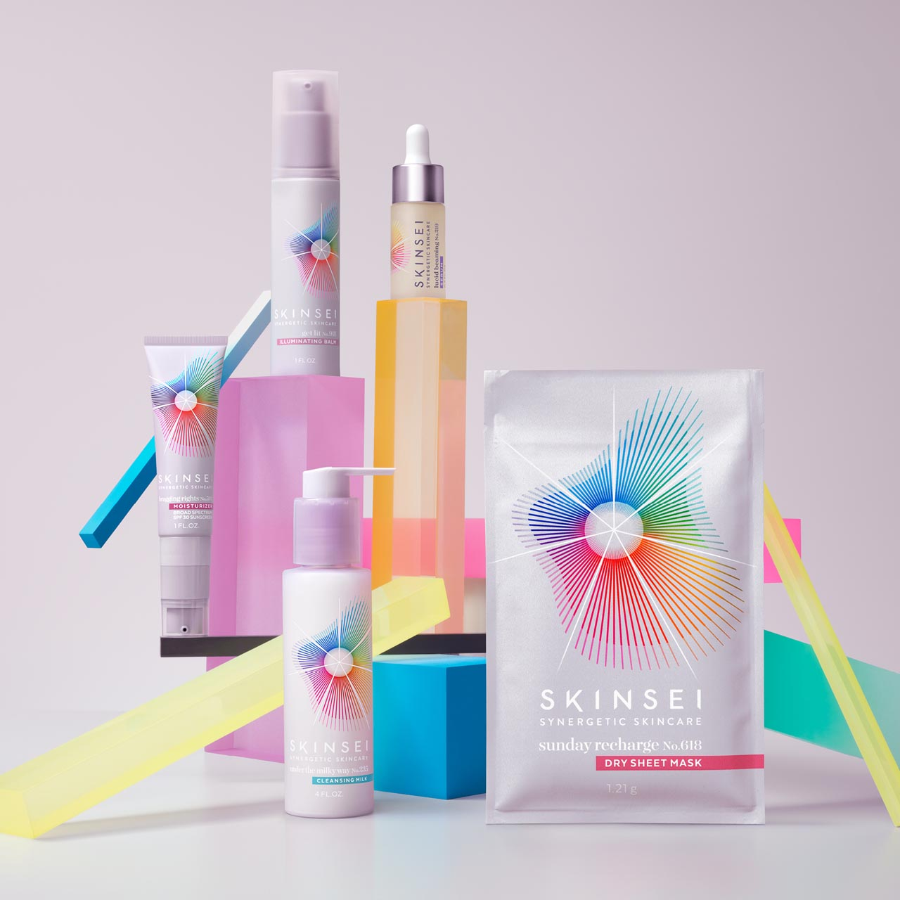 Subscription kit of Skinsei products, arranged on pastel-colored geometric shapes.