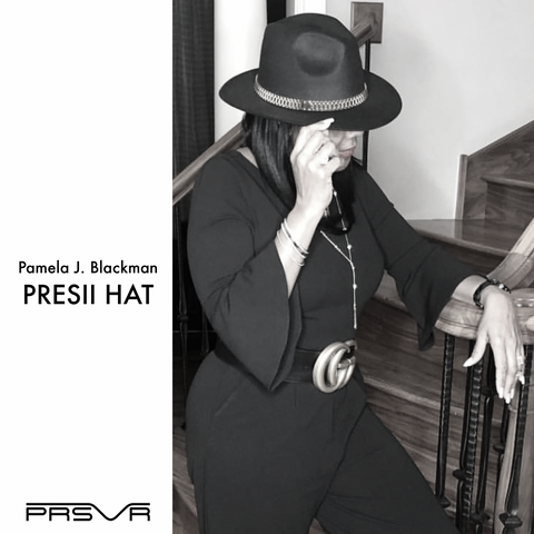 Pam Blackman wearing the PRSVR Presii Rolex Hat
