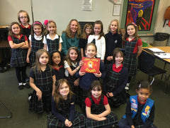 Self-publised children's book author, Melissa Bixby, visits with a Daisy Troop in Palatine, Illinois.