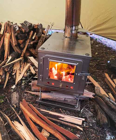 Wood Stove Inside Tent with Firewood