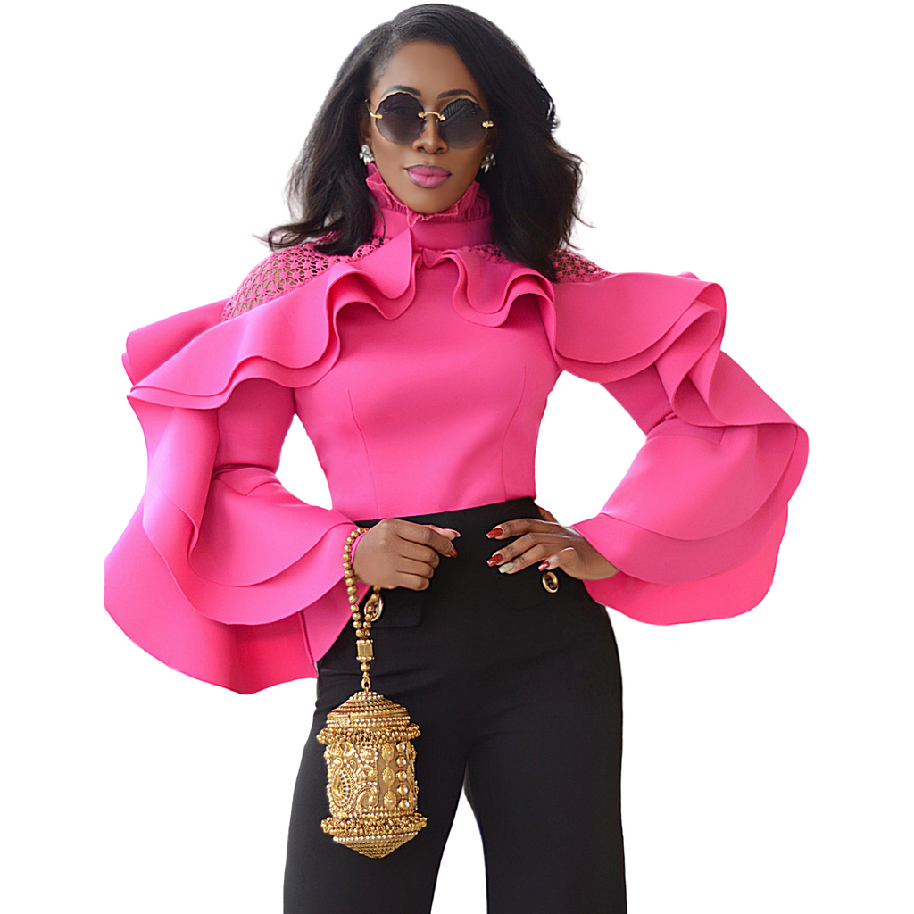 Pink scuba material blouse with dramatic flared sleeves and high neck ruffle. Top offers lace at the shoulder and back zip closure.  Edit alt text