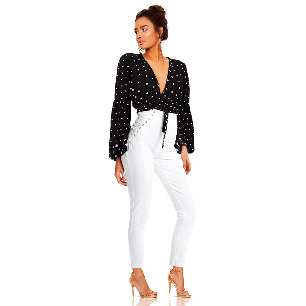 White form fitted pant with shoe string lace up side design with gold eyelet accent. Pants offers a skinny leg fit with inside ankle zipper