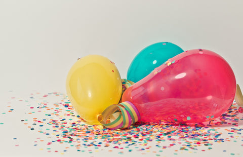 Party decorations like balloons and confetti