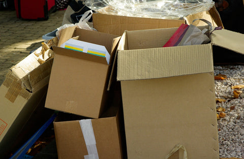 Unsustainable packaging cartons and boxes