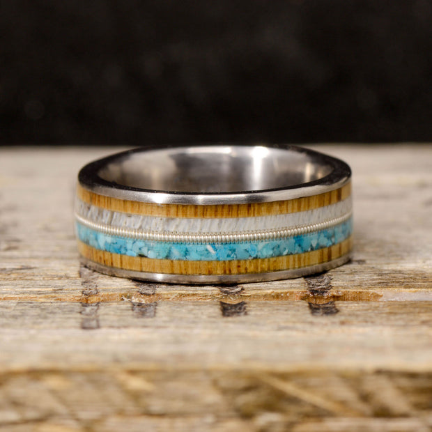 Antler, Guitar String, and Turquoise Channel