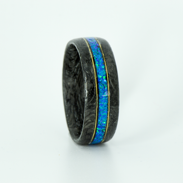 SALE RING - Forged Carbon Fiber, Guitar Strings, and Blue Opal - Size 12