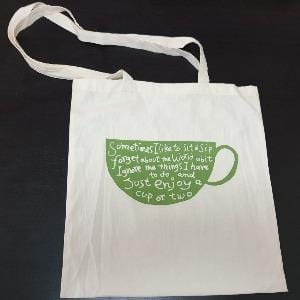 Calico Tote Bag with Quote of Sit and Sip in green