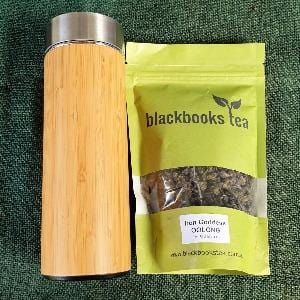 Bamboo and stainless steel infuser bottle with pouch of oolong tea
