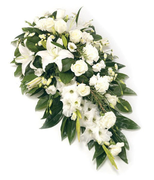 Flowers for funerals: A classic single ended spray of white Roses, Lilies, Eustoma and Gladioli with dark green foliage.