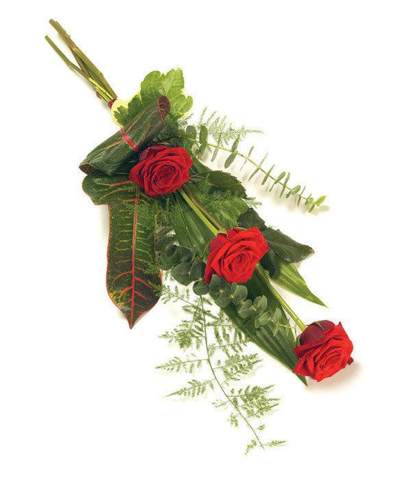 Flowers for funerals: A classic and elegant sheaf of 3 roses and complementary foliage tied with a ribbon.