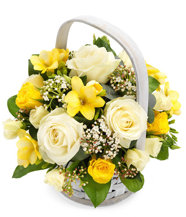 Flowers for funerals: A pretty white wash basket arrangement containing white and yellow Roses together with yellow Lisianthus and white Viburnum.