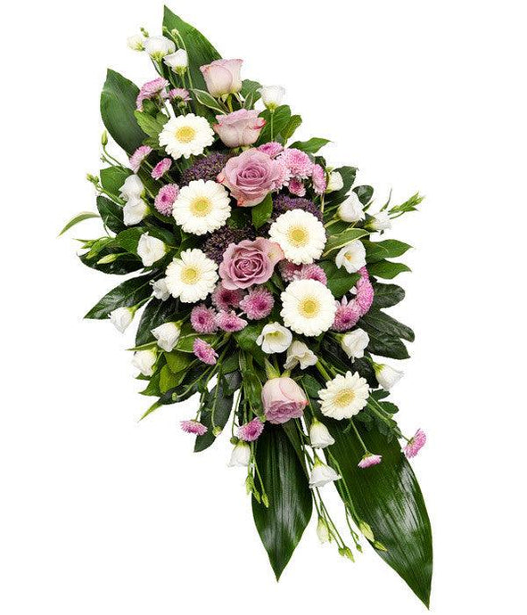 Flowers for funerals: A double ended spray of lilac Roses, white Germini, Lisianthus, purple Trachelium and lavender Chrysanthemums.