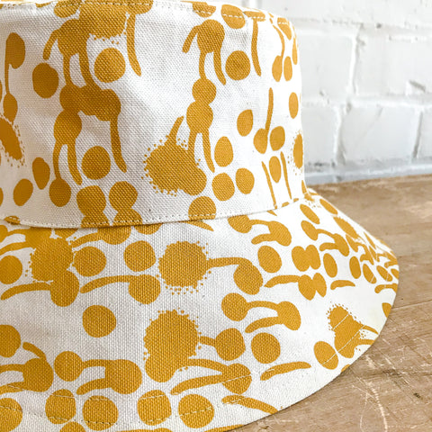 GOLD BERRIES BUCKET HAT BY ERIN FLETT