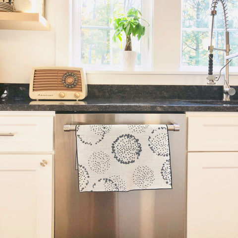 DANDELION LINEN TEA TOWEL IN CHARCOAL ON OATMEAL