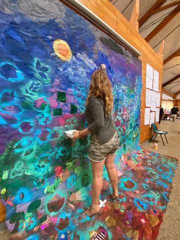 Aubrey working on a mural in upstate NY. She is rocking her upcycled rubber adventure jewelry.