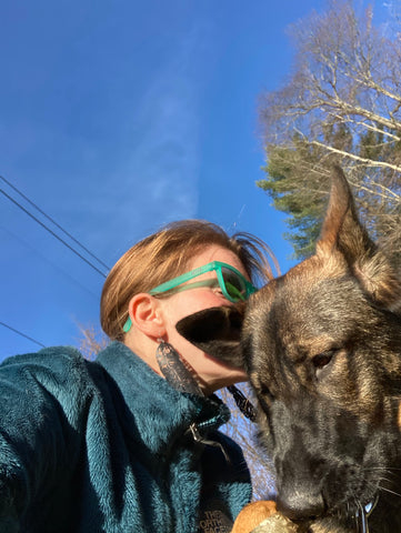 Amanda and her dog Lolly. Amanda is rocking the lori feather earring, an up-cycled rubber adventure jewelry.