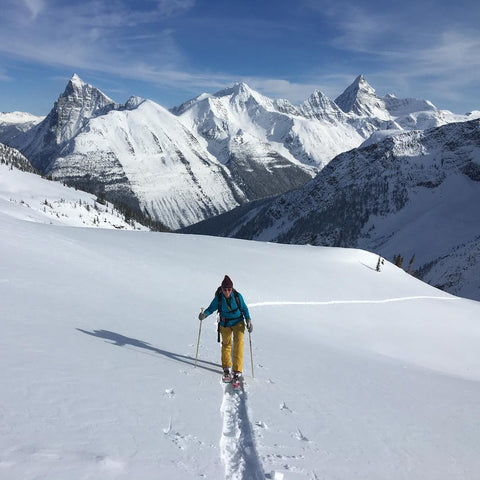 Keitha backcountry skiing in British Columbia, CA. Wearing her up-cycled rubber adventure jewelry, ABD Culture.