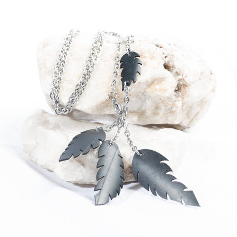 a-symmetrical feather necklace