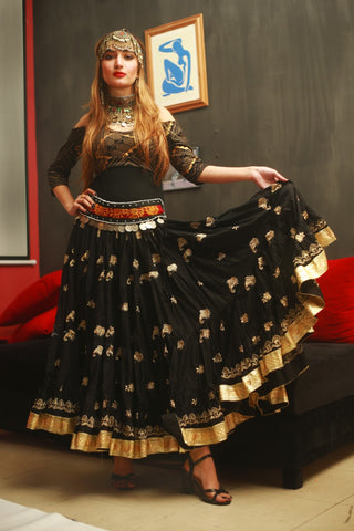 Black skirt with gold embroidery and gold border