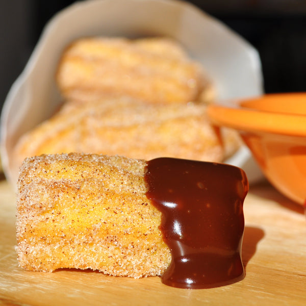 Churro Bites with Spicy Caramel Chocolate Dipping Sauce