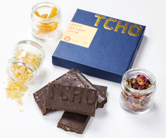 Limited Edition TCHO Taste Chasers Chocolate Bar with featured ingredients: yuzu, ginger, and rose