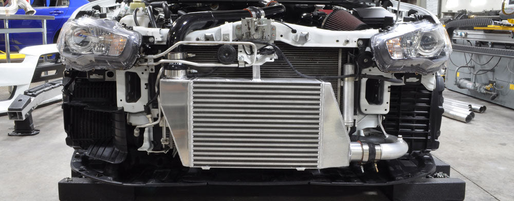 Evo ten six inch race intercooler mounted on the car with no front bumper