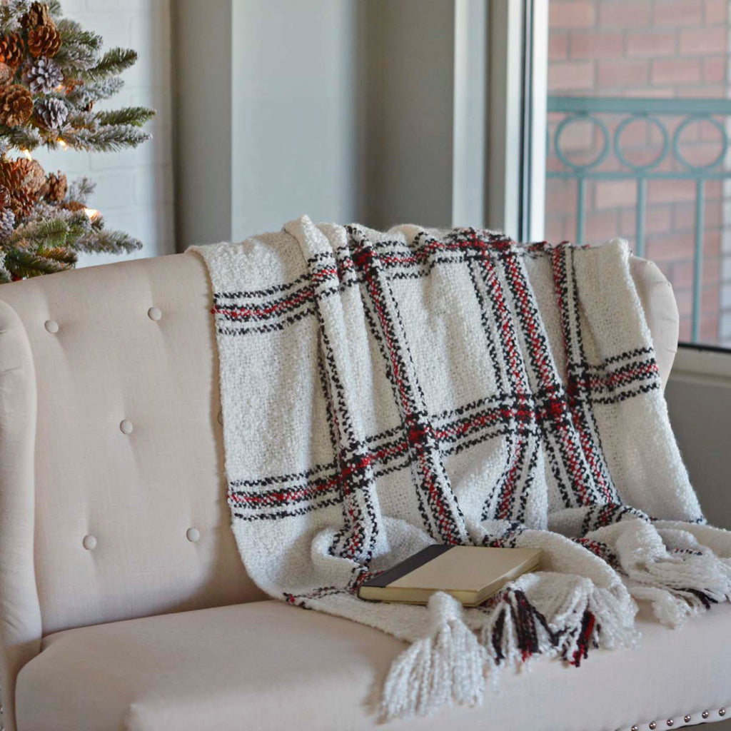 black, cream, and red plaid throw blanket