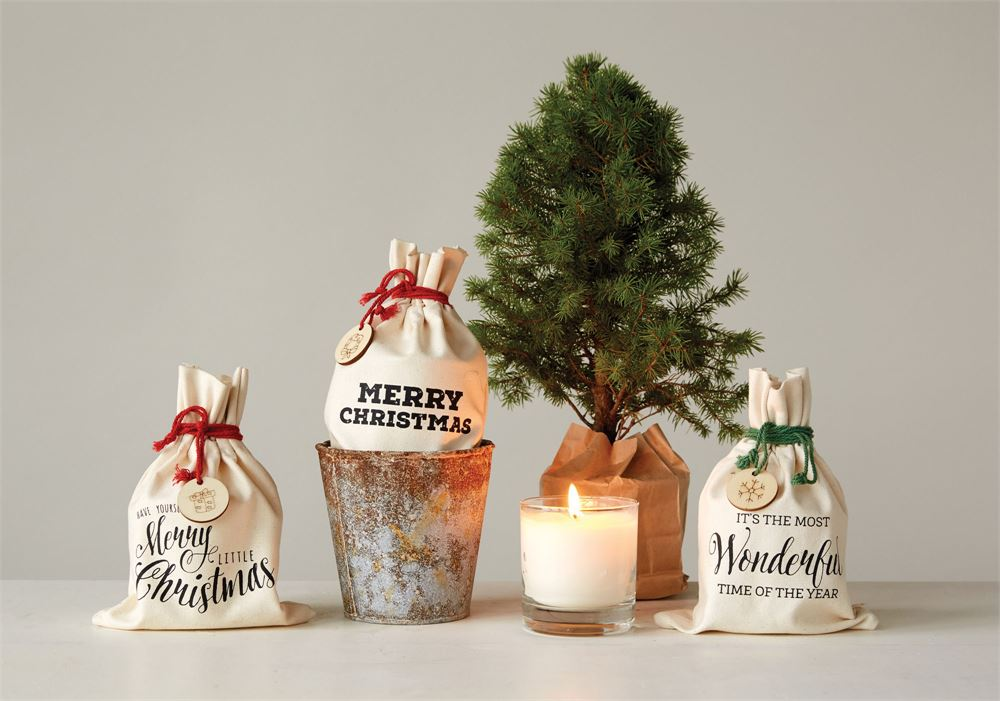 festive Christmas scented candles in gift bag with wood slice charm