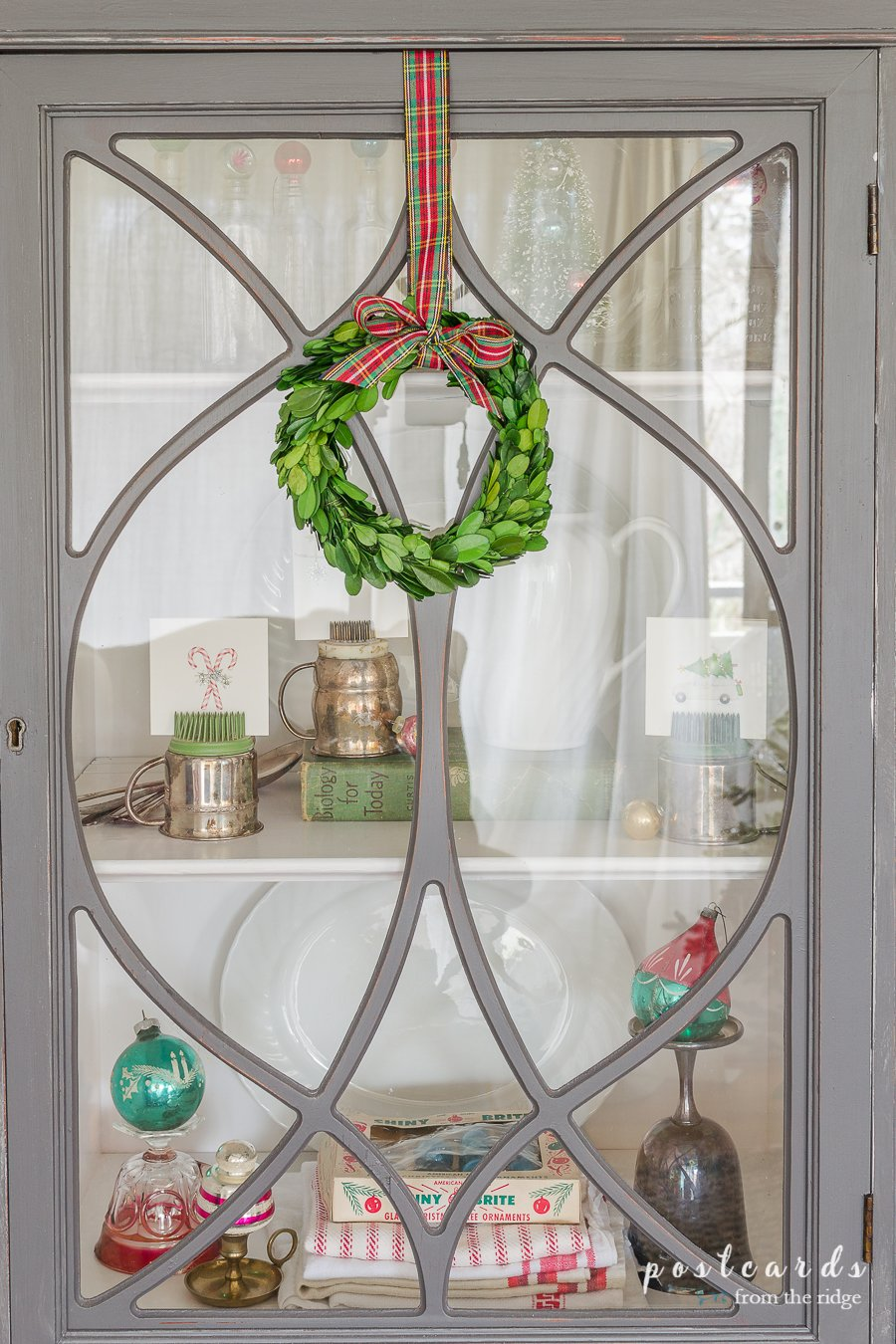 preserved boxwood wreath with plaid ribbon