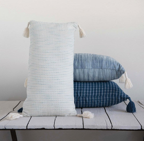 blue pillows with tassels