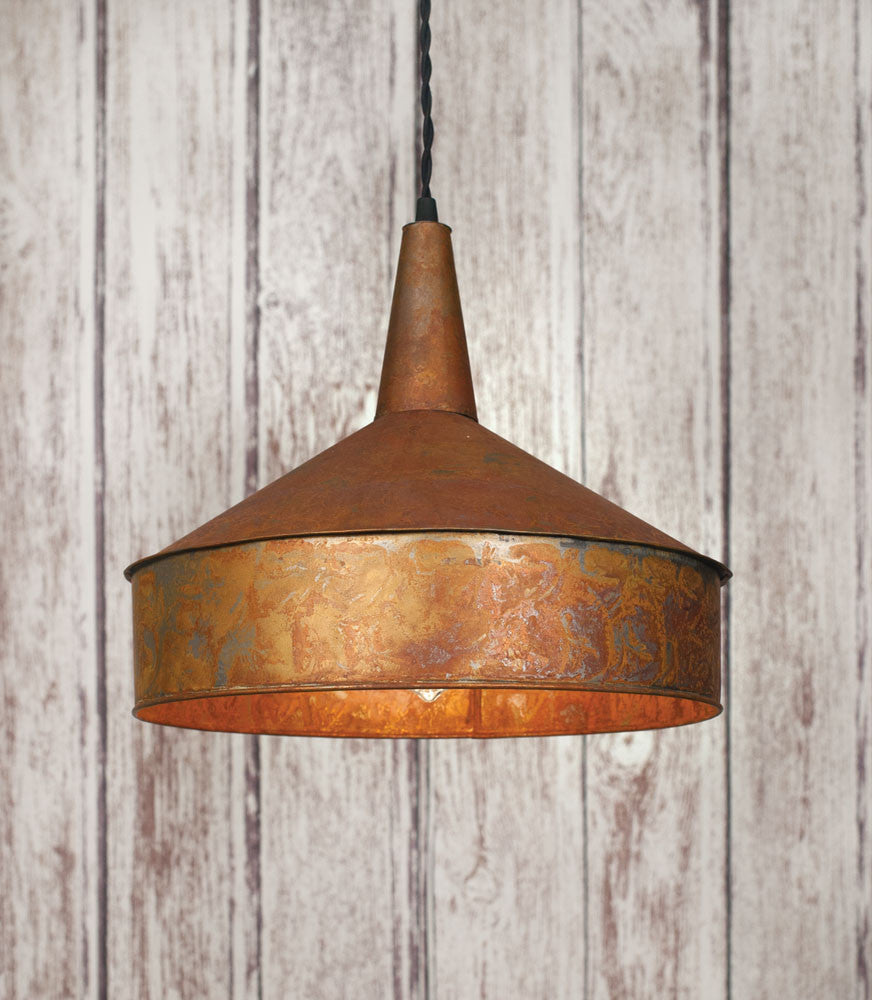 Rustic farmhouse style pendant light made from a funnel and painted copper