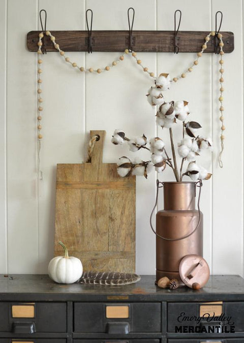 Rustic wood wall rack with vintage hooks