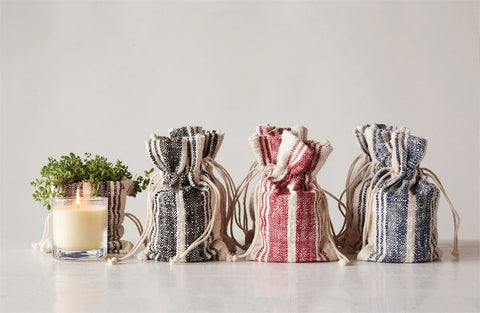 Orange Vanilla Candles with striped grain sack bag