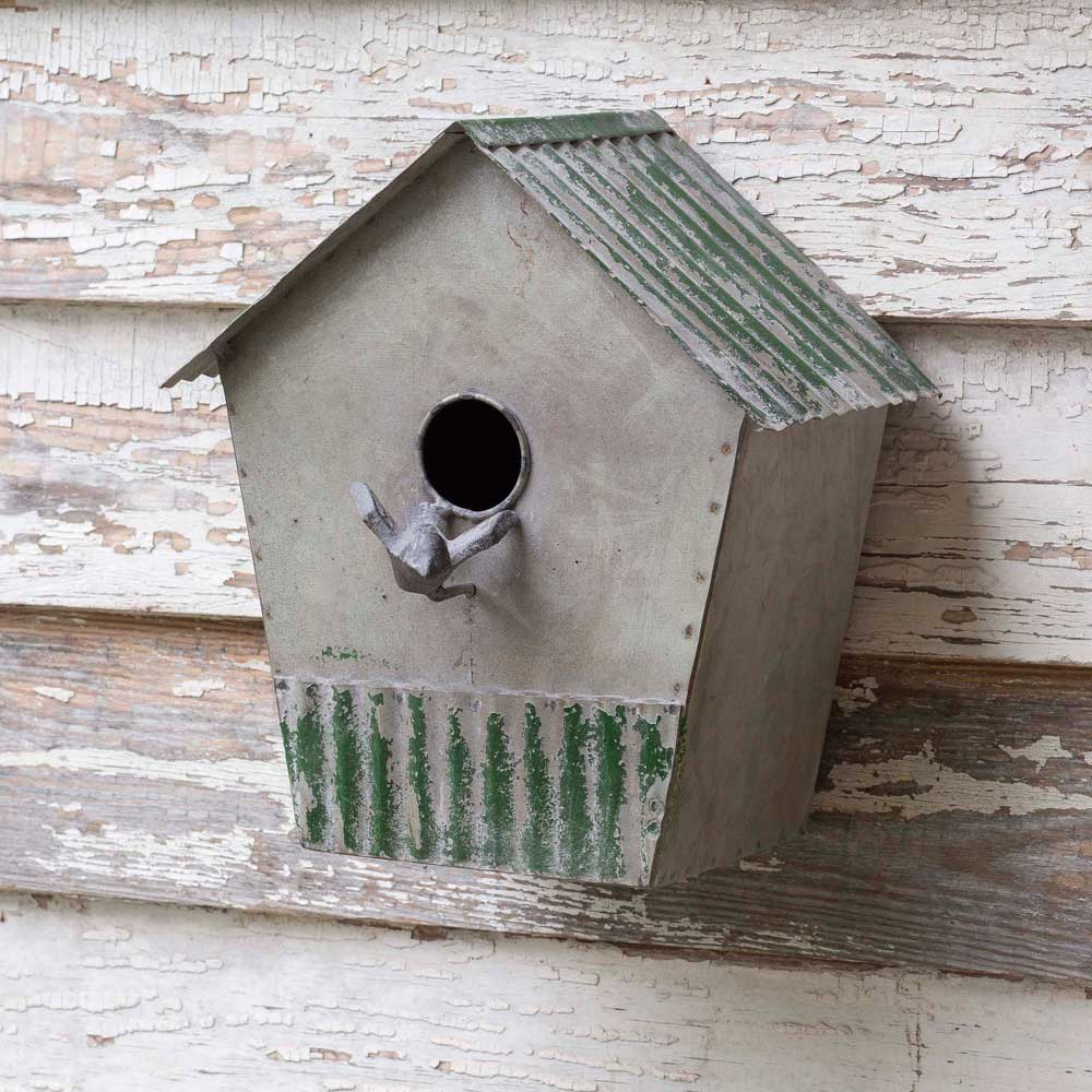 metal birdhouse with corrugated roof