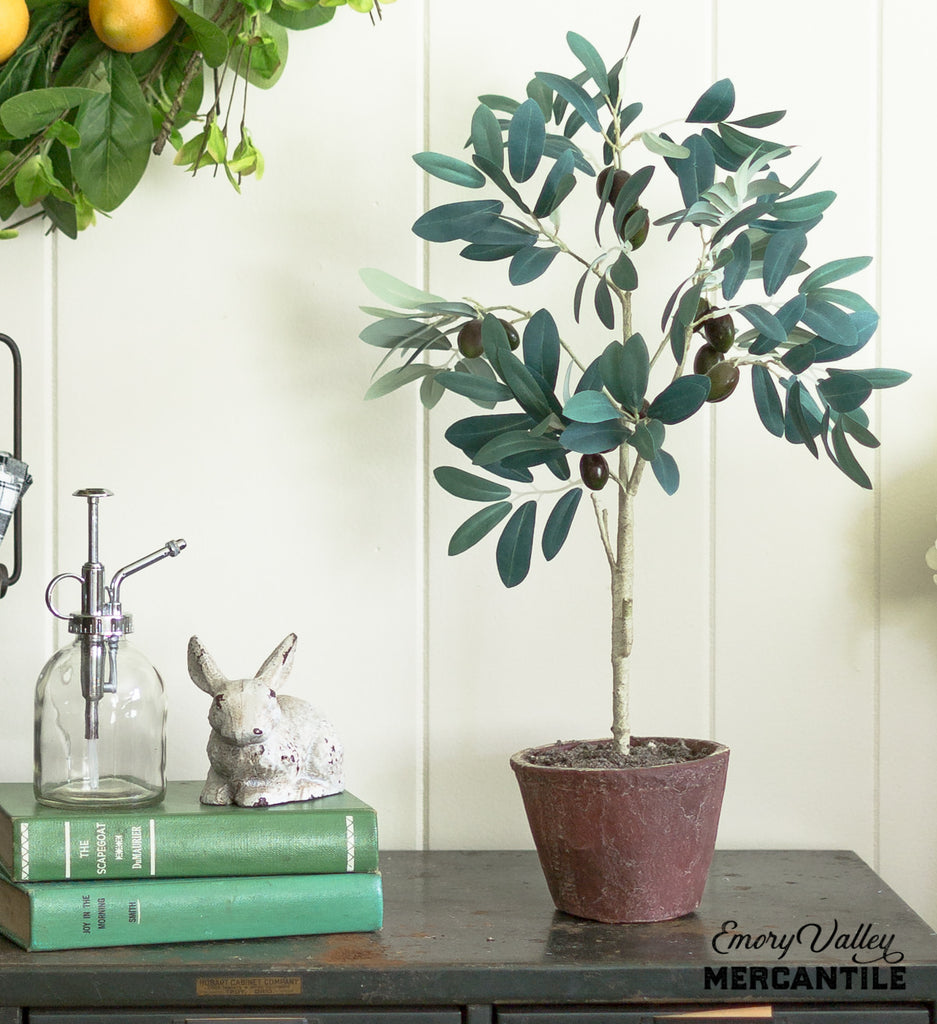 faux artificial olive tree in terracotta pot
