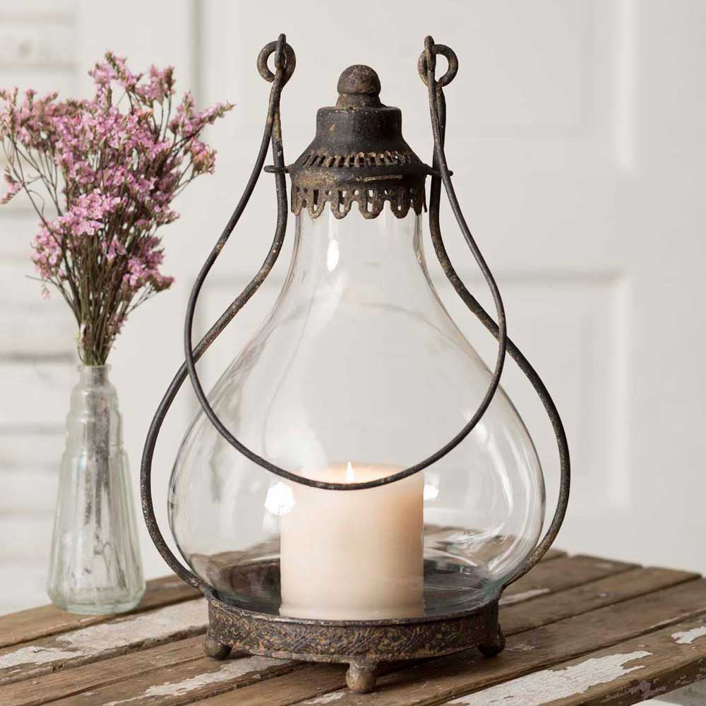 Glass and metal hurricane style candle lantern