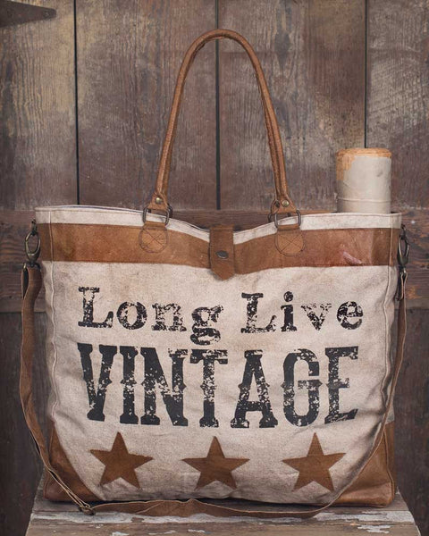Long live vintage canvas and leather tote
