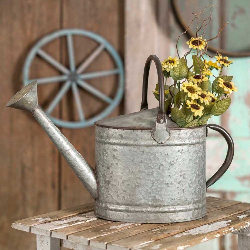 Farmhouse style decorative metal watering can