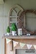 preserved boxwood topiary with rustic spring mantel decor